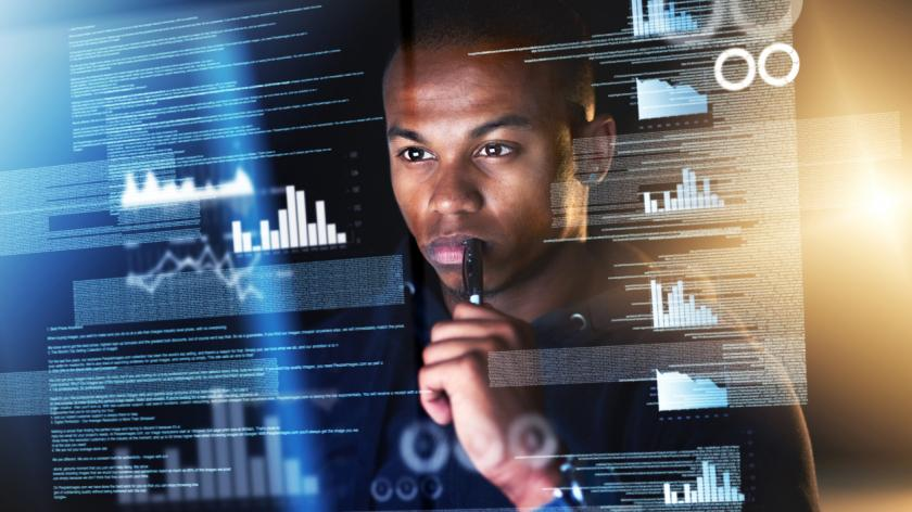 Cropped shot of a young male programmer sifting through data streams while coding