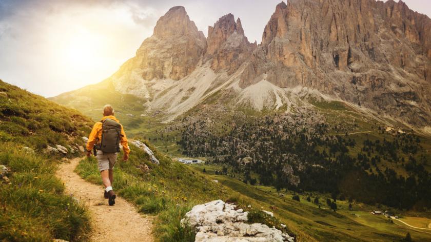 man trail hiking on high mountain
