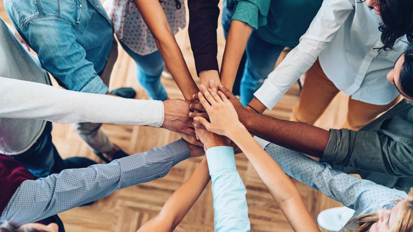 team linking hands