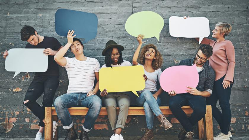 employees holding up speech bubbles