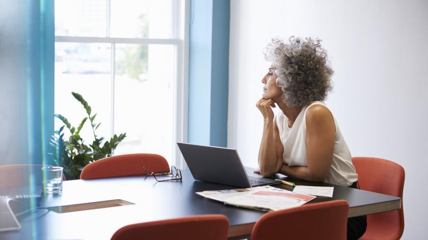 Woman reflecting at work