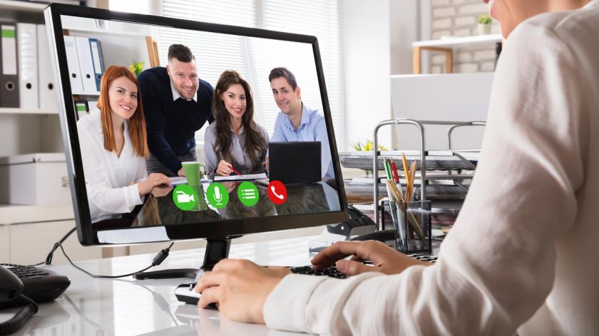 business woman video conferencing her team