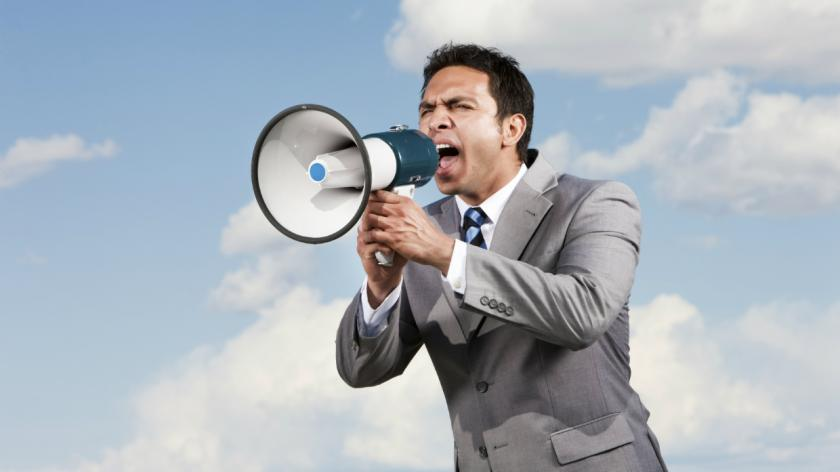 A man shouting into a megaphone