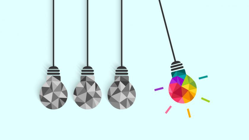Newton's cradle pendulum concept with lightbulbs