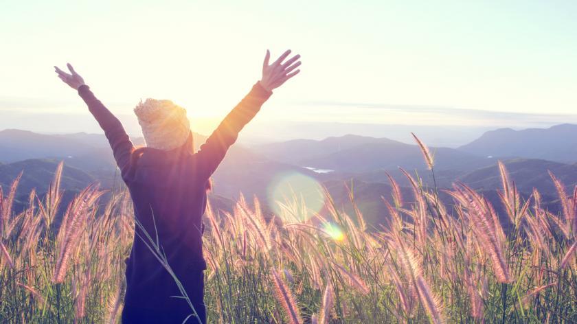Woman Enjoying Nature in meadow
