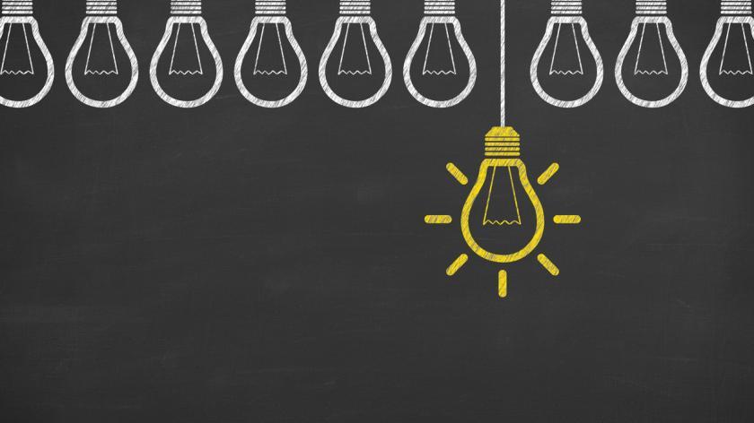 Idea concept with light bulbs on a chalkboard background