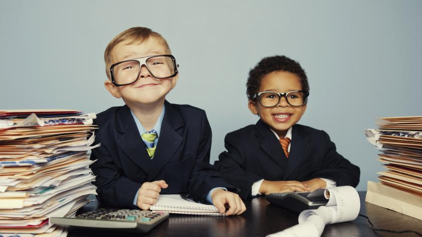 Children playing grown up businessmen