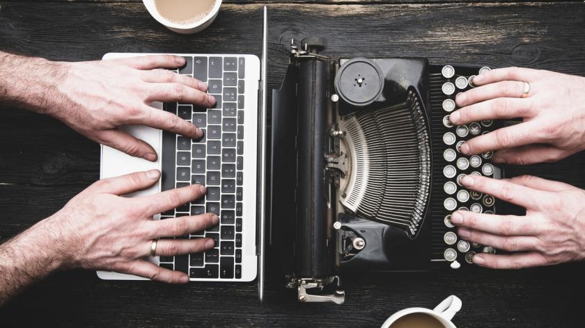 Old typewriter and new laptop
