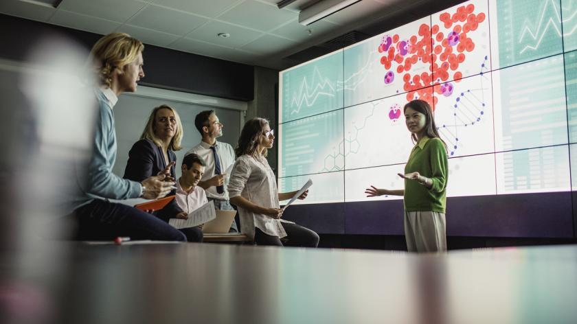 Woman giving presentation on big screen