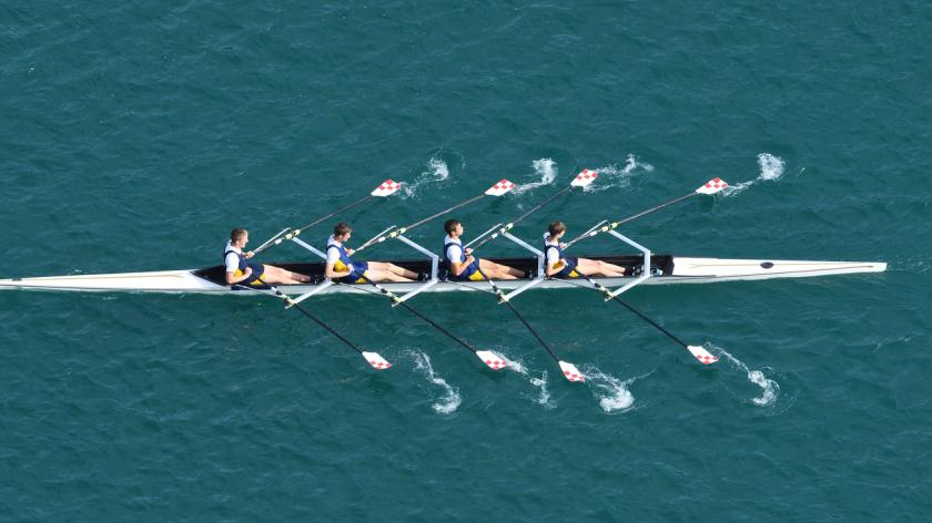 rowing team on river