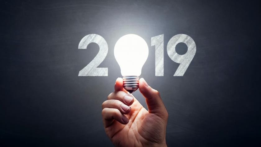 New Year 2019 - Light Bulb Hand Idea Blackboard